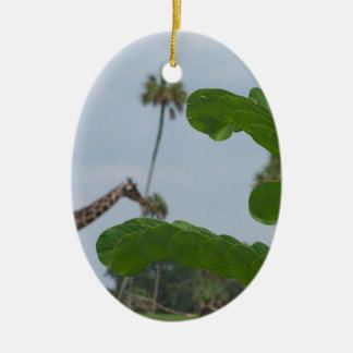 Plant and blue sky with giraffes in the background christmas tree ornament