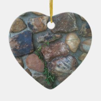 Plant climbing a stone wall ceramic ornament