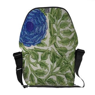 Planta con una flor azul (w/c en el papel) bolsa de mensajería