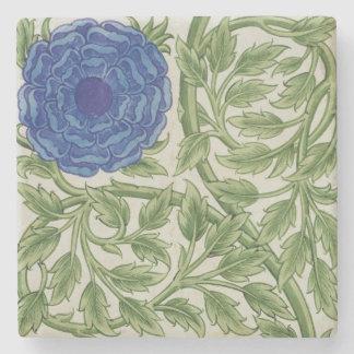 Planta con una flor azul (w/c en el papel) posavasos de piedra