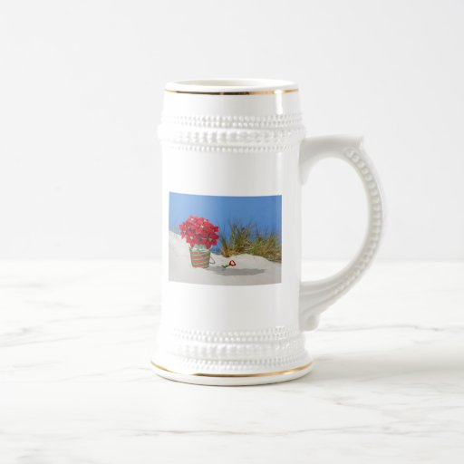 Planta de Pointsettia del cubo de la arena Tazas