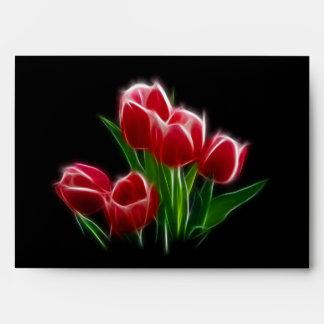 Planta del rojo de la flor del tulipán sobres