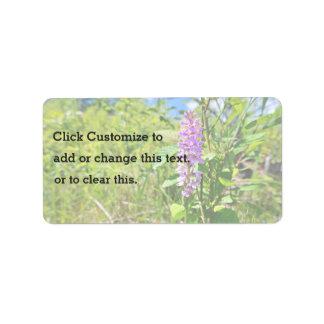 Planta púrpura de la flor etiqueta de dirección