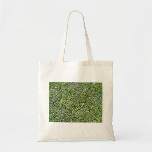 Plantas que crecen en paisaje herboso verde bolsa lienzo