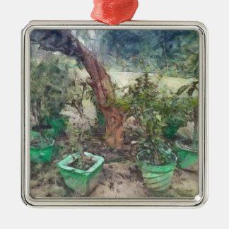 Plantas y un árbol adorno navideño cuadrado de metal