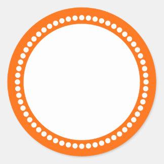 Plantilla redonda del marco del punto en naranja pegatina redonda
