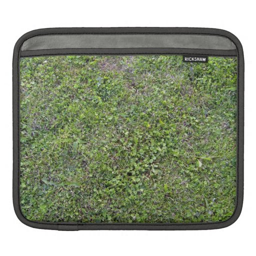 Plants Growing On Green Grassy Landscape iPad Sleeve
