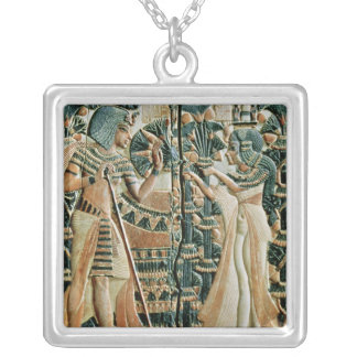 Plaque from the lid of coffer showing silver plated necklace