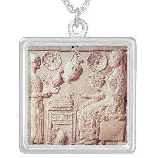 Plaque of a woman offering gifts to a seated silver plated necklace