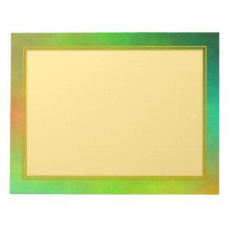 Plasma verde sin forro con los cuadernos de notas