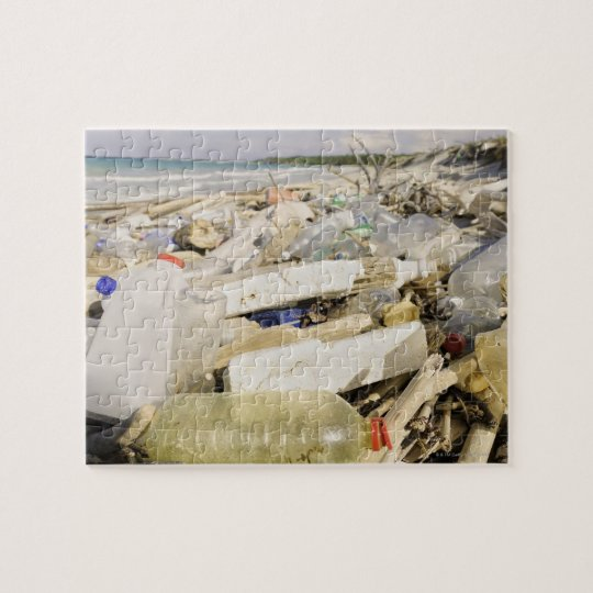 Plastic bottles and ocean dumping on a tropical jigsaw puzzle