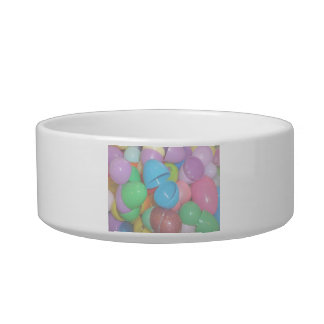 plastic colourful easter eggs pastel background pet food bowl