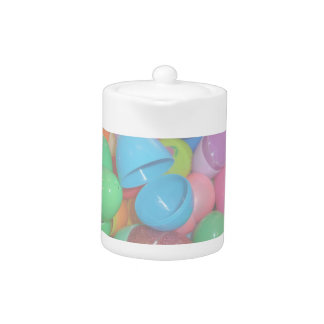 plastic colourful easter eggs pastel background teapot