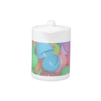 plastic colourful easter eggs pastel background teapot