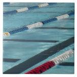 Plastic separators in a swimming pool creating ceramic tiles