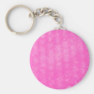 Plástico de burbujas plástico rosado llavero redondo tipo pin