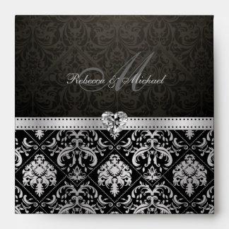 Plata elegante y sobres negros del damasco