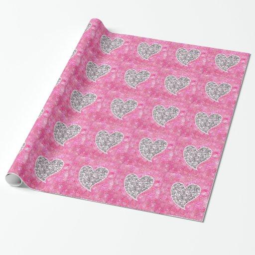 Plata y corazones relucientes del rosa papel de regalo