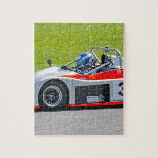 Plata y solo coche de competición rojo del seater rompecabeza con fotos