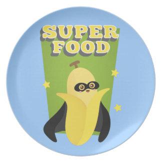 Plátano lindo con el cabo, comida estupenda, con s plato para fiesta