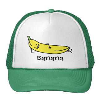 Plátano que es sonriente, colocando y relajándose gorro