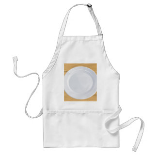 Plate and cutlery on wooden table standard apron