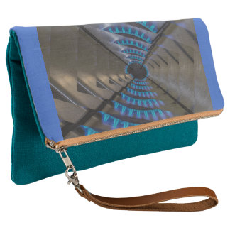 plate of gas lit on Teal Fold-Over Clutch