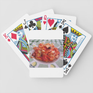 Plate of home made baked pasta on white background bicycle playing cards