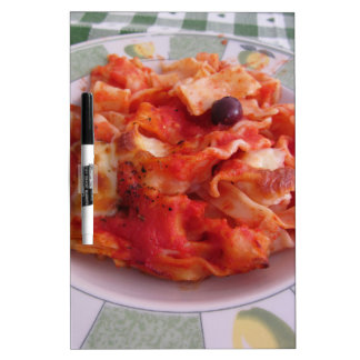 Plate of home made baked pasta on white background Dry-Erase board