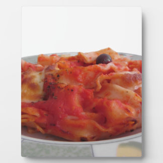 Plate of home made baked pasta on white background plaque