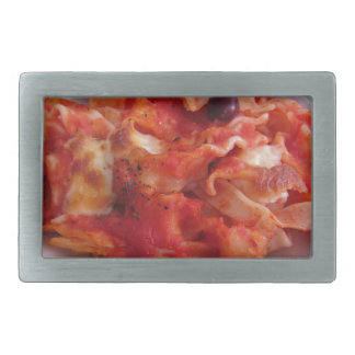 Plate of home made baked pasta on white background rectangular belt buckle