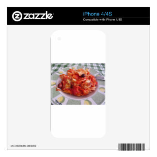 Plate of home made baked pasta on white background skins for the iPhone 4