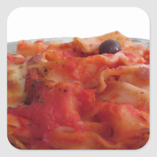 Plate of home made baked pasta on white background square sticker