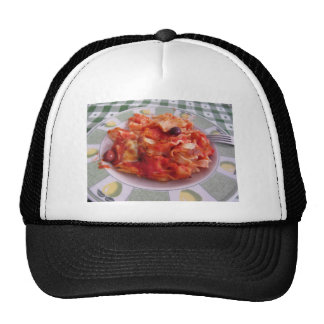 Plate of home made baked pasta on white background trucker hat