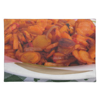 Plate of stir-fried carrots cloth placemat