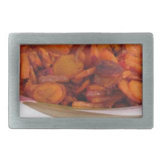 Plate of stir-fried carrots rectangular belt buckle