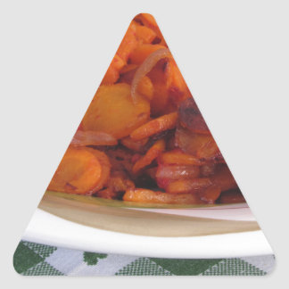 Plate of stir-fried carrots triangle sticker