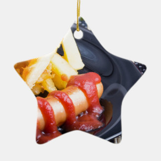 Plate with a portion of fried potatoes ceramic ornament