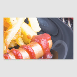 Plate with a portion of fried potatoes rectangular sticker