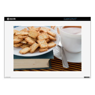 Plate with crackers and cup of tea laptop skin