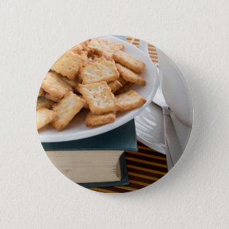 Plate with crackers and cup of tea pinback button