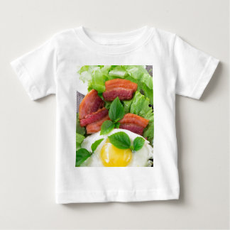 Plate with egg yolk, fried bacon and herbs baby T-Shirt