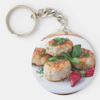 Plate with fried meatballs minced chicken keychain