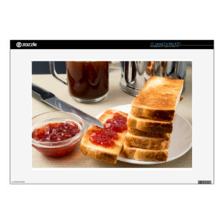 Plate with fried slices of bread for breakfast laptop decal