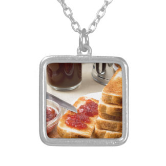 Plate with fried slices of bread for breakfast silver plated necklace