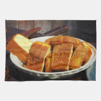 Plate With Sliced Bread and Knives Kitchen Towel