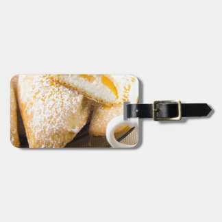 Plate with sweet pastries with sweet cheese luggage tag