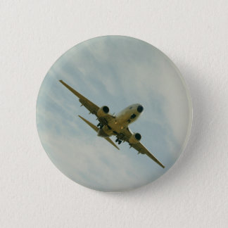Plate with vintage airplane pinback button