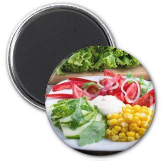Plato de los tomates, campana-pimienta, queso de imán redondo 5 cm