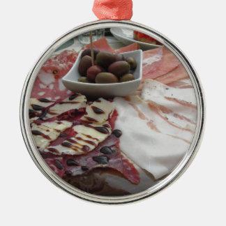 Platter of cold cuts with rustic ham prosciutto metal ornament